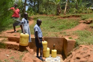 The Water Project: Ebukuya Special School for the Deaf -  Collecting Water At The Spring