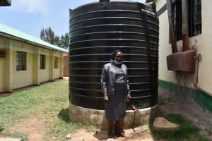The Water Project: Ebukuya Special School for the Deaf -  Madam Ochieng At The Rain Tank