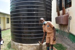 The Water Project: Ebukuya Special School for the Deaf -  Pupil Fabian At The Rain Tank
