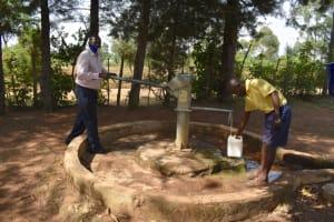 The Water Project: Namushiya Primary School -  School Headteacher Drawing Water