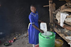 The Water Project: Namushiya Primary School -  Adding To Water Storage In The Kitchen