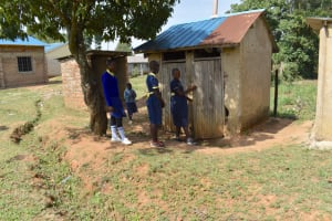The Water Project: Namushiya Primary School -  Girls Lined Up To Use Latrines