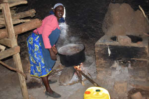 The Water Project: Namushiya Primary School -  School Cook At Work Inside The Kitchen