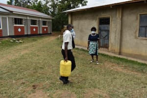 The Water Project: Salvation Army Matioli Secondary School -  Carrying Water