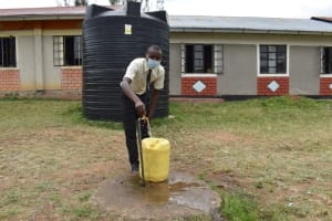 The Water Project: Salvation Army Matioli Secondary School -  Collecting Water At Rain Tank Fed Standpipe