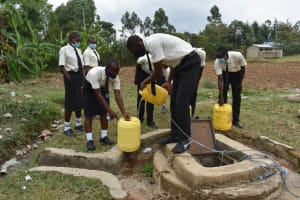 The Water Project: Salvation Army Matioli Secondary School -  Collecting Water At The Well