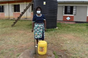 The Water Project: Salvation Army Matioli Secondary School -  Principal Ruth Mayavi Fetching Water At Rain Tank Fed Standpipe