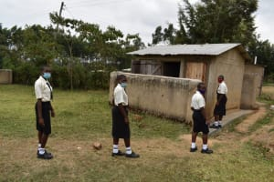 The Water Project: Salvation Army Matioli Secondary School -  Students In Line Outside Pit Latrine