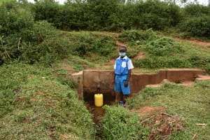 The Water Project: Friends Mudindi Village Primary School -  Collecting Water At The Spring