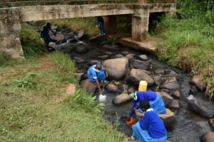 The Water Project: Friends Mudindi Village Primary School -  Collecting Water At Underpass Stream