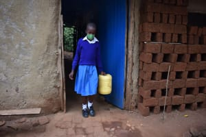 The Water Project: Friends Mudindi Village Primary School -  Getting Water From Home