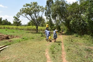 The Water Project: St. Elizabeth Shipala Primary School -  Carrying Water
