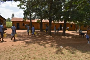 The Water Project: St. Elizabeth Shipala Primary School -  Arriving At School With Water
