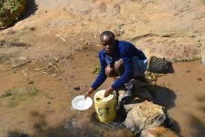 The Water Project: St. Kizito Shihingo Primary School -  Angela Fetching Water
