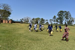 The Water Project: St. Kizito Shihingo Primary School -  Carrying Water