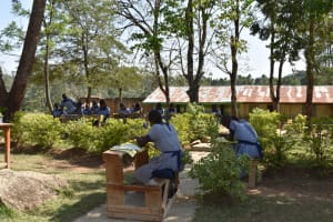 The Water Project: St. Kizito Shihingo Primary School -  Students Attend Class Under Tree Shade