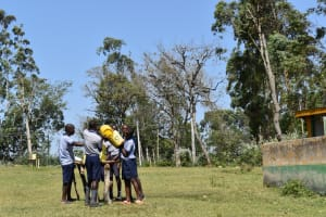 The Water Project: St. Kizito Shihingo Primary School -  Boys Fill Their Handwashing Facility With Water