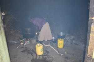 The Water Project: St. Kizito Shihingo Primary School -  School Cook At Work Inside The Smoky Kitchen