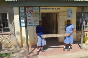 The Water Project: St. Kizito Shihingo Primary School -  Students Show The School Sign