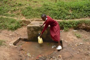 The Water Project: Kapkeruge Primary School -  Ashley Fetching Water