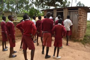 The Water Project: Kapkeruge Primary School -  Boys Queueing At The Latrines