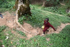 The Water Project: Kapkeruge Primary School -  Climbing Hilly Road With Water