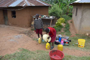 The Water Project: Kapkeruge Primary School -  Collecting Water From Home