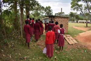 The Water Project: Kapkeruge Primary School -  Girls Queueing At Their Latrines