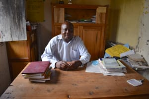 The Water Project: Kapkeruge Primary School -  Headteacher Fred Indeche In His Office