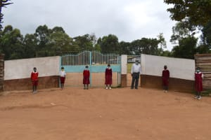 The Water Project: Kapkeruge Primary School -  Students And Headteacher At The Gate