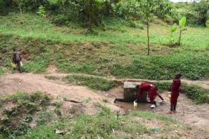 The Water Project: Kapkeruge Primary School -  Students Collecting Water