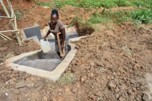 The Water Project: Maraba Community, Shisia Spring -  Sheila Leaving The Spring With Water