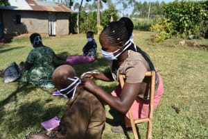 The Water Project: Maraba Community, Shisia Spring -  Sheila Ties Her Mamas Mask