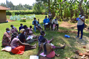 The Water Project: Maraba Community, Shisia Spring -  Trainer Jacky Leads Mask Making Tutorial