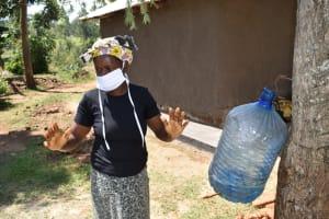 The Water Project: Maraba Community, Shisia Spring -  Demonstrating Air Drying Afer Handwashing