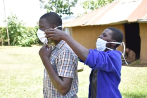 The Water Project: Maraba Community, Shisia Spring -  Trying On A New Mask