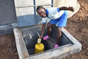 The Water Project: St. Peter's Ebunga'le Primary School -  A Pupil Fetching Drinking Water