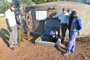 The Water Project: St. Peter's Ebunga'le Primary School -  Teachers And Field Officer Elvine Pose Formally At The Tank