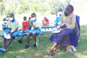 The Water Project: St. Peter's Ebunga'le Primary School -  Teacher Taking Notes At Training