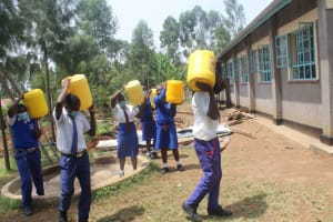 The Water Project: St. Stephens ACK Eshiakhulo Secondary School -  Students Carrying Water