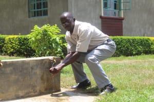 The Water Project: Epanja Secondary School -  Mr Nyongesa At A Rain Tank Tap