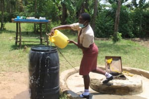 The Water Project: Epanja Secondary School -  Sharon Adding Water To Storage Drum