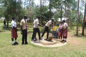 The Water Project: Epanja Secondary School -  Getting A Drink From The Well
