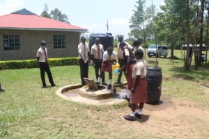 The Water Project: Epanja Secondary School -  Getting A Drinkg From The Well