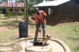 The Water Project: Epanja Secondary School -  School Cook Pulling Water From The Well