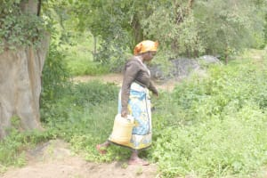 The Water Project: Kasioni Community D -  Carrying Water