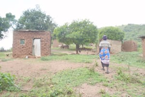 The Water Project: Nzimba Community C -  Walking Into Compound