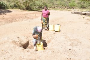 The Water Project: Kyamwalye Community -  At The Scoop Hole