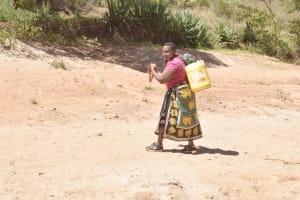 The Water Project: Kyamwalye Community -  Carrying Water