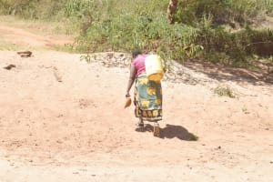 The Water Project: Kyamwalye Community -  Carrying Water Home